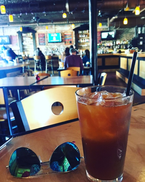 Enjoying an espresso lemonade at a cool spot in Tampa's Ybor City.